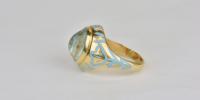 Aquamarine ring in 18k gold with light blue enamel