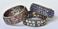 Bracelets with tourmaline, opal and tanzanite set in silver with diamonds.