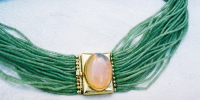 Dog collar in 22k gold with honey opal and strands of jade.