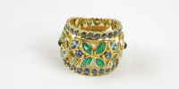 Marquis ring. The marquis cut gems form 5 flowers. Emerald, aquamarine and sapphire in 18k gold.