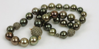 Tahiti pearl necklace with rose diamond balls and lock.