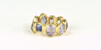 Sluis Juwelen   9 steensring met ceylon saffieren in 18 karaat goud