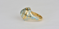 Aquamarine ring in 18k gold with light blue enamel