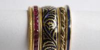 Sliding rings in 18k gold, ruby and enamel.