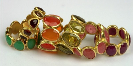 9 stone rings in 18k gold and various stones.