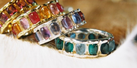Flower Rings in 18k gold and 14k white gold with cabochon cut sapphires and tourmaline.