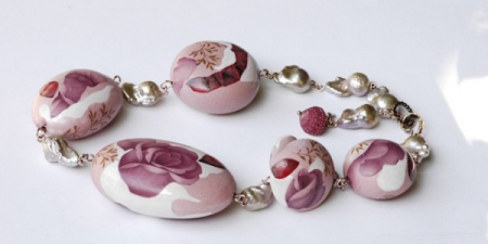 Hollow molded porcelain beads decorated with rose petals, 18k gold and pearls.