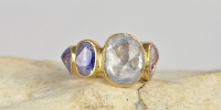 9 stone ring, heavy 18k gold ring with cylon sapphires